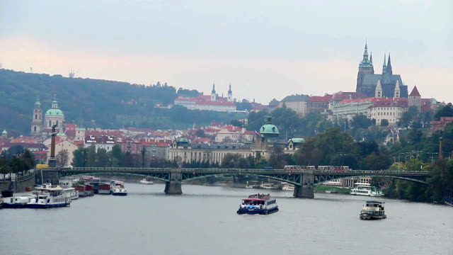 Prague bridge riverside view Castle Petrin mountain Vltava river. Beautiful shot of Europe, culture and landscapes. Traveling sightseeing, tourist views landmarks of Czech Republic. World travel, west European trip cityscape, outdoor shot video