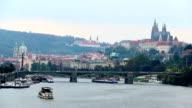 Prague riverside bridges view, timelapse Castle Petrin mountain. Beautiful shot of Europe, culture and landscapes. Traveling sightseeing, tourist views landmarks of Czech Republic. World travel, west European trip cityscape, outdoor shot video