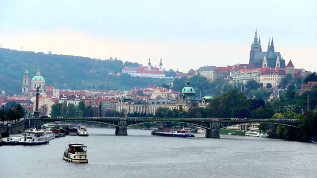 Prague riverside bridges view, timelapse Castle Petrin mountain. Beautiful shot of Europe, culture and landscapes. Traveling sightseeing, tourist views landmarks of Czech Republic. World travel, west European trip cityscape, outdoor shot video