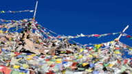 Prayer flags in the mountains of India with blue sky video