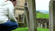 praying on the tomb of the father: cemetery, religion, searching of god, faith video