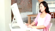 Pregnant asian woman using computer video