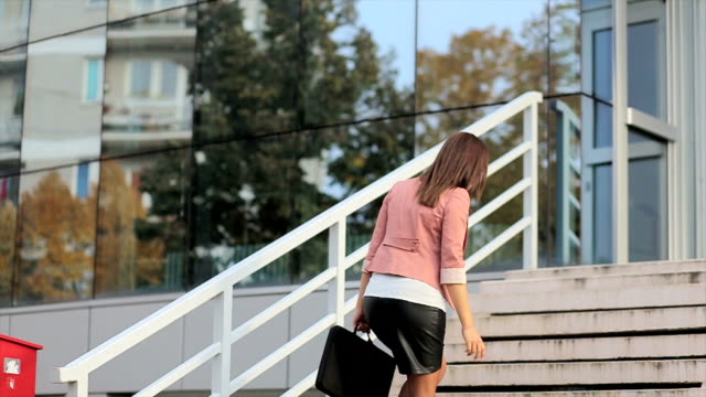 Pregnant business woman walking to her place of work video
