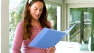 Pregnant businesswoman reading a file video