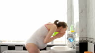 pregnant Woman during morning toilet video