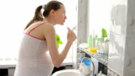 pregnant woman during the morning hygiene procedures video