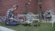 4K: Pregnant Woman Gardening In A Backyard. video