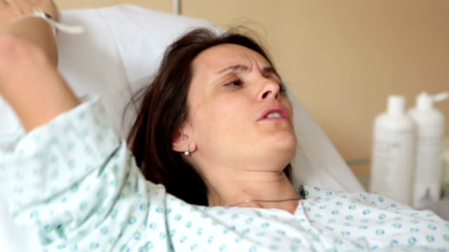 Pregnant woman in delivery room, having contractions video