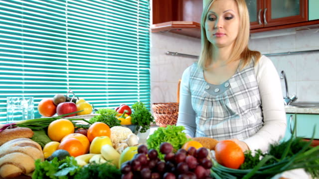 Pregnant woman in kitchen video