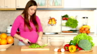 Pregnant woman making a salad video