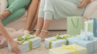 Pregnant woman receiving gifts at baby shower video