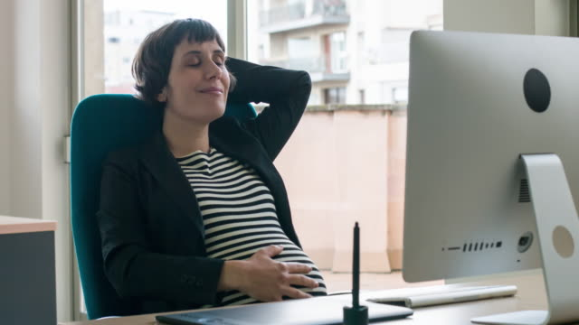 Pregnant woman relaxed in the office video