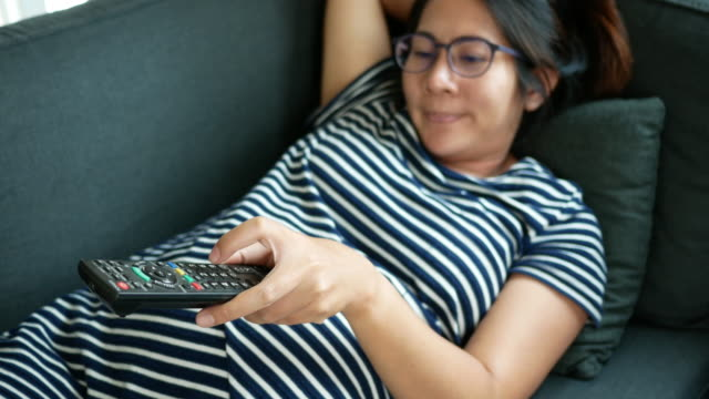 Pregnant woman using remote control video
