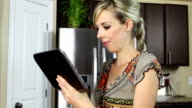 Pregnant woman with digital tablet video