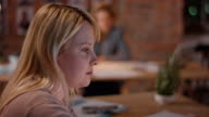 Pregnant woman working behind office desk in startup company video