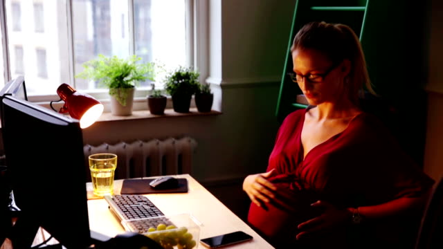 Pregnant Woman Working Late Again video