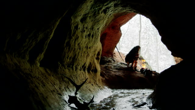 Prehistoric caveman goes to his cave video