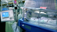 Prematurely born infant lying in incubator video