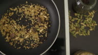 Preparation of basic Indian cooking with dry raw spices video