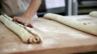 Preparation of braided sweet bun in bakery video