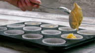 Preparation of cake. Expanding the dough for the cake pan. Close-up. video