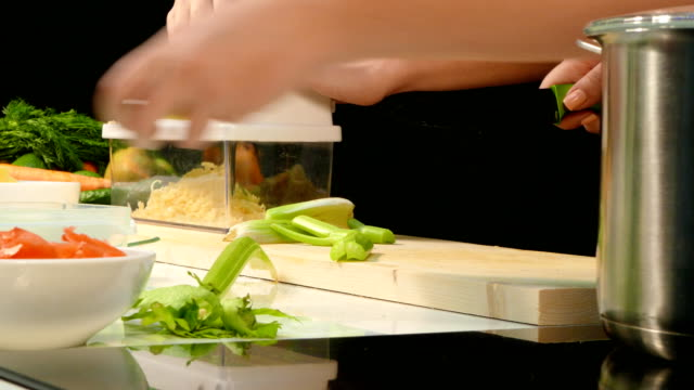 Preparation of celery and cheese for dishes video