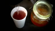 Preparation of herbal tea with jam. video