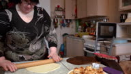 Preparation of homemade pizza on a light kitchen table. video