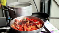 preparation of Lobster with tomatoes in a pan for Italian pasta video