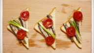 Preparation of tapas with sardines, sprats, stop motion, animation video