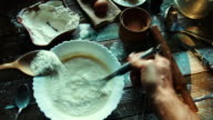 Preparation of the dough in a rustic kitchen video