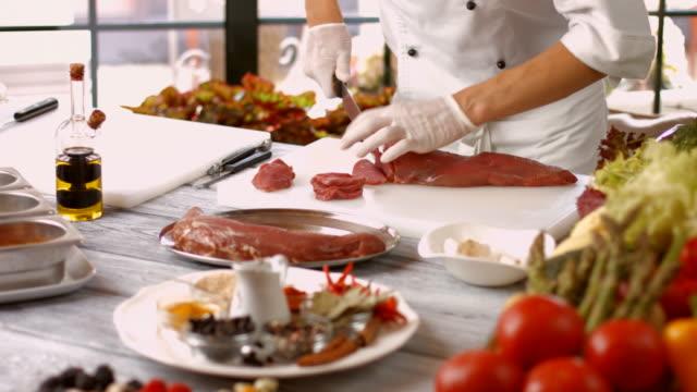 Preparation of veal in restaurant. video