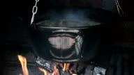 Preparin lunch in a cauldron video