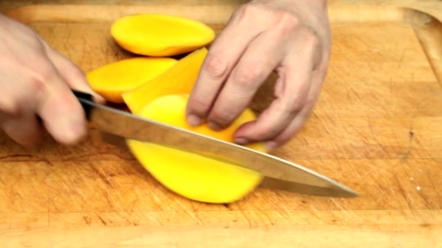 Preparing, Cutting Mango with Kitchen Knife (4 of 5) (Video) video