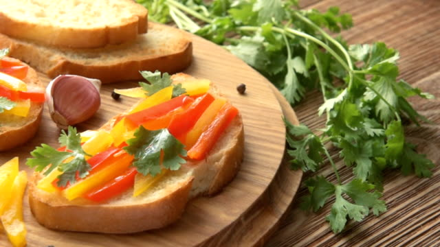 Preparing delicious Italian bruschetta with chopped vegetables video