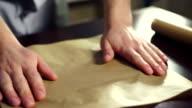 Preparing for baking cake. Cook putting baking paper on baking pan video