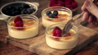 Preparing Homemade Creme Brulee with Berries video