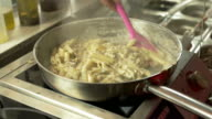 Preparing Pasta with Mushrooms, Herbs and Cheese video