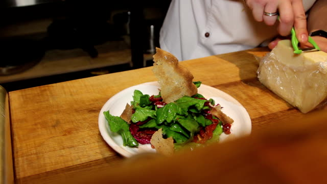 preparing salad with cabbage and dried tomatoes in restaurant video