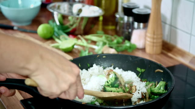 Preparing Vegetables and Chicken in a Wok for Nasi Goreng video