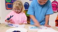 Preschool children finger painting video