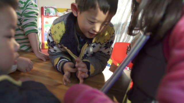 preschool teacher teaching children in classroom video
