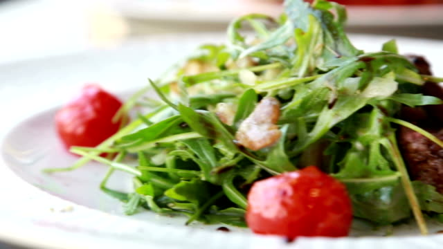 Presentation of Fresh food salad with ruccola cherry tomatoes and meat steak of beef video