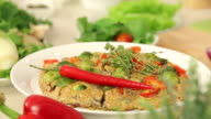 Presentation of Omelette with Red Paprika, Brussel Sprouts and Onions with Herbs on a Plate video