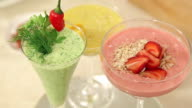 Presentation of Strawberry, Green Vegetables and Citrus Smoothies Decorated in Glasses video