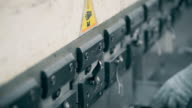 press to bend steel weight presses down and create a folded metal parts. worker bending sheet metal with a production machine machine work video