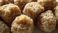 Pressed brown sugar cubes, macro dolly shot video
