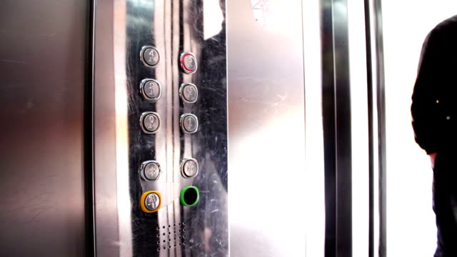 Presses a Button In An Elevator video