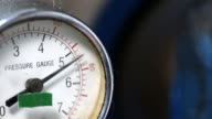 Pressure gauge with compressor working. video