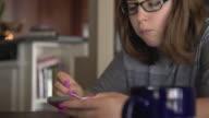 Pre-teen girl on mobile phone video